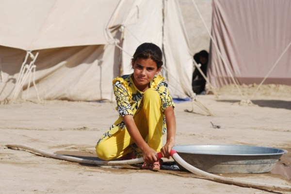 A displaced girl at one of the camps reached by Soccer Salam near Bzeibiz bridge outside Ramadi, Iraq.