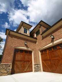 Brick House with Wooden Garage Door