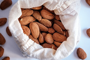 Almond has high in magnesium, which helps to stimulate the digestive tract