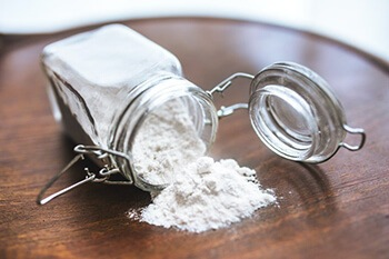 Use baking soda to absorb odor in the pillow
