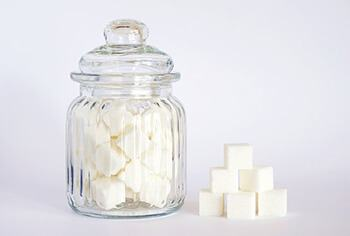 eating too many sugary food can cause white spots in your teeth