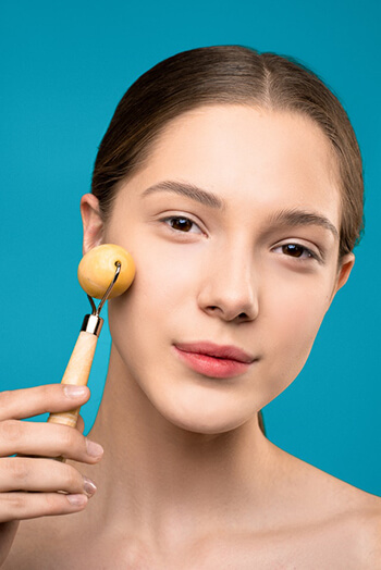 woman with face roller