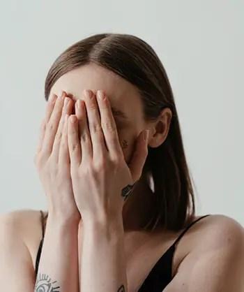 hiding face woman