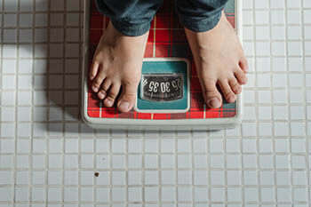 person in weighing scale