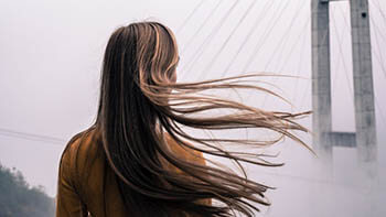 person with flowy hair