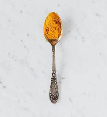 turmeric on spoon