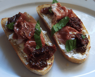 Sun Dried Tomato, Prosciutto, and Goat Cheese Bruschetta
