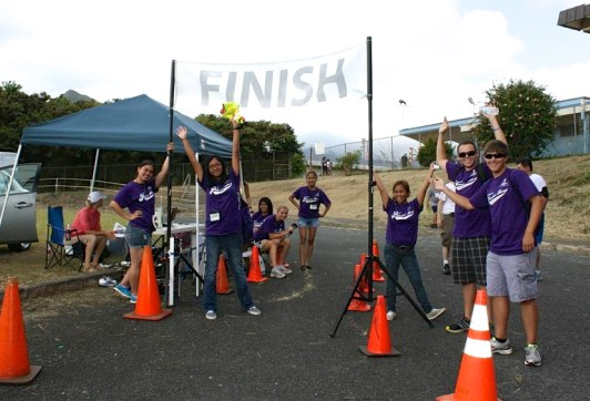 Volunteers from UH-Manoa's Health Careers Opportunity Program (HCOP) cheer on runners at the Freedom Run.