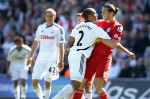 Ashley Williams stands up to Andy Carroll