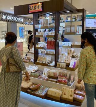 Women looking at a rakhi display.