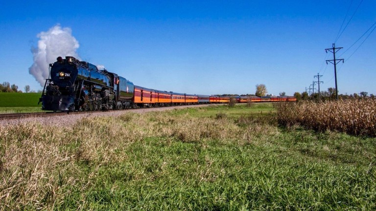 Steam engine pulling train