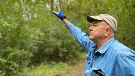 Glenn Olson motions upward as discusses the buckthorn problem in the Edenvale Conservation Area.