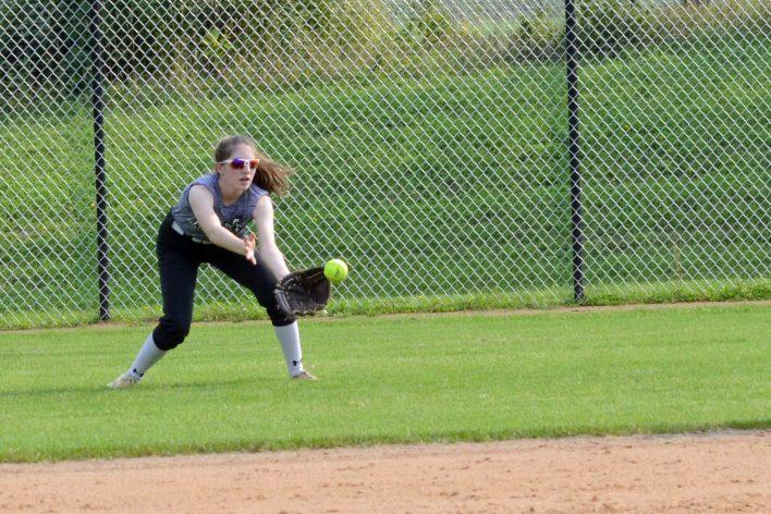 Natalie Black fielding a ball in centerfield