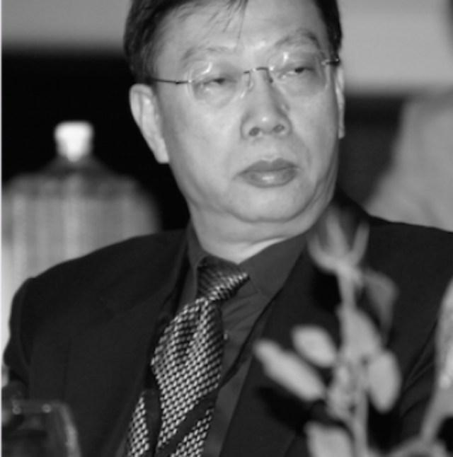 Ex-vice-ministro da Saúde chinês Huang Jiefu durante conferência da OMS (Rony/AFP/Getty Images)