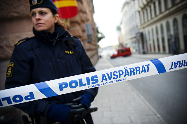A police officer stands guard as a police and fire department team inspects a street and building where a suspicious package was found, next to the Rosenbad government office, in Stockholm, on October 13, 2011. Police said they had evacuated parts of Sweden's government building, which houses Prime Minister Fredrik Reinfeldt's offices, after a suspicious package triggered a bomb scare. AFP PHOTO/JONATHAN NACKSTRAND (Photo credit should read JONATHAN NACKSTRAND/AFP/Getty Images)