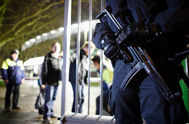 HANOVER, GERMANY - NOVEMBER 17: Police forces secure an entrance of the the HDI-Arena prior the International Friendly match between Germany and Netherlands at HDI Arena on November 17, 2015 in Hanover, Germany. (Photo by Matthias Hangst/Bongarts/Getty Images)
