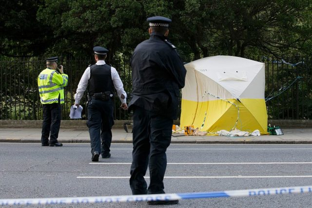 Police personnel are pictured at a crime scene in Russell Square in central London on August 4, 2016, following a knife attack in which one woman was killed and five others injured. A woman was killed and five people injured in a knife attack in central London Wednesday which police said they are investigating for possible terrorist links. A 19-year-old man was arrested in Russell Square, in the city centre, which was cordoned off after the attack as police swarmed the area. / AFP / JUSTIN TALLIS (Photo credit should read JUSTIN TALLIS/AFP/Getty Images)