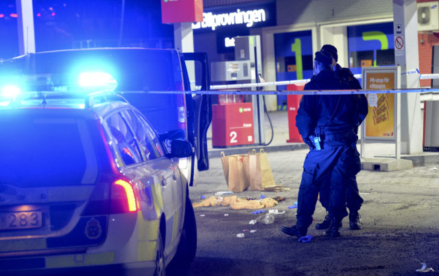 Police have cordened off an area at a gas station where a man was fond severely injured in a minivan after being shot on the sidelines of a pro-Kurdish demonstration in Fittja in southern Stockholm, Sweden, on February 13, 2016. / AFP / TT News Agency / Johan Nilsson/TT / Sweden OUT (Photo credit should read JOHAN NILSSON/TT/AFP/Getty Images)