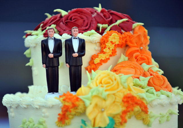 A wedding cake with statuettes of two men is seen during the demonstration in West Hollywood, California, May 15, 2008, after the decision by the California Supreme Court to effectively greenlight same-sex marriage. AFP PHOTO / GABRIEL BOUYS (Photo credit should read GABRIEL BOUYS/AFP/Getty Images)