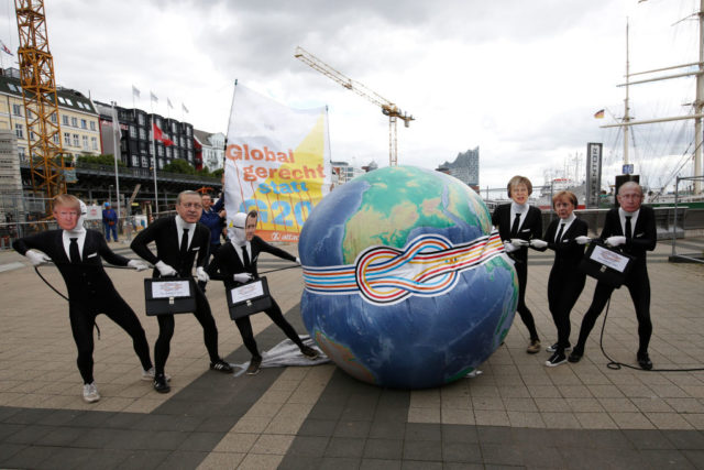 HAMBURG, GERMANY - JULY 4: ATTAC activists, dressed as G20 leaders pose for a photo during a protest action at the harbour prior to the G20 Summit in Hamburg on July 4, 2017 in Hamburg, Germany. Hamburg will host the upcoming G20 summit on July 7 and 8. (Photo by Morris MacMatzen/Getty Images)