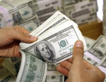 В Германии осуждена сотрудница банка, переводившая деньги на счета бедняков. Фото: ЮНГА YEON-JE/AFP/Getty