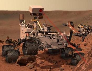Лазерным лучом Curiosity испарит каменную породу и исследует поверхность Марса инструментальной «рукой». Фото: abendblatt.de