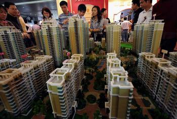 Китайская компартия развивает города, увеличивая расслоение общества. Фото: China Photos/Getty Images