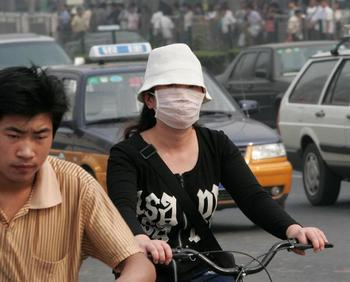 Чтобы уровень загрязнения воздуха в городе Гуанчжоу достиг нормы, будут закрыты сотни предприятий. Фото: AFP/Getty Images