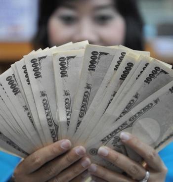 Япония не видит в Китае конкурента в экономическом развитии. Фото: BAY ISMOYO/AFP/Getty Images