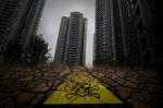 В Китае жилые дома строят на неочищенной земле бывших химических промзон. Фото с epochtimes.com