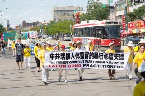 Мероприятия последователей Фалуньгун, посвящённые годовщине начала преследования этой практики в коммунистическом Китае. Торонто, Канада. Июль 2013 года. Фото: The Epoch Times