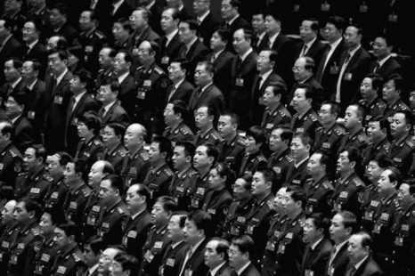 Китайские чиновники в 2012 году. Фото: Feng Li/Getty Images