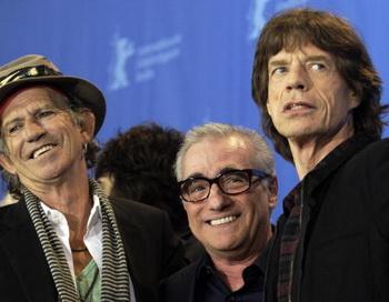 Участники группы Rolling Stones Кейт Ричардс и Мик Джаггер с режиссером Мартином Скорсезе на премьере фильма « Rolling Stones: Да будет свет». Фото: SASCHA SCHUERMANN/AFP/Getty Images