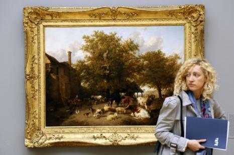 Картина Т.С. Купера «Доение коров на лугу» 1864 года на выставке национальной коллекции британского искусства в Тейте в Лондоне. Фото: Warrick Page/Getty Images