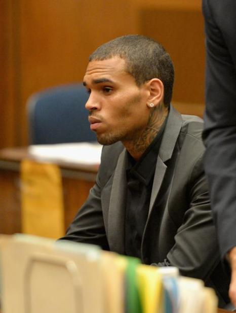 Крис Браун посетил 15 июля 2013 года судебное слушание по делу 2009 года об избиении Рианны в Лос-Анджелесе (США), в ходе которого был отменён условный срок. Фото: Alberto E. Rodriguez/Getty Images
