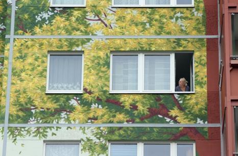 Общество художников организации «Креативный город» (Citecreation), расписали фасады трёх зданий Берлина размером 22 тысячи квадратных метров. 20 августа 2013 года. Работа претендует на рекорд Гиннеса. Фото: Sean Gallup/Getty Images