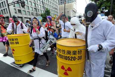 Токио. Акция протеста. Фото: KAZUHIRO NOGI/AFP/GettyImages