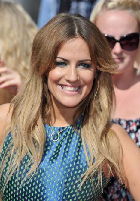 Телеведущая Кэролайн Флэк прибыла на прослушивания шоу талантов «X-фактор» в Лондоне 15 июля 2013 года. Фото: Gareth Cattermole/Getty Images