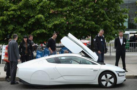 Конференция по электромобилям на правительственном уровне проходит в берлинском Конгресс-центре 27 мая 2013 г. Фото: Sean Gallup/Getty Images