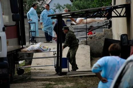 Тела погибших в наводнения на Кубани. Фото:  MIKHAIL MORDASOV/AFP/GettyImages