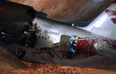 Фоторепортаж о крушении Ту-204 в аэропорту Внуково. Фото: NATALIA KOLESNIKOVA/AFP/Getty Images