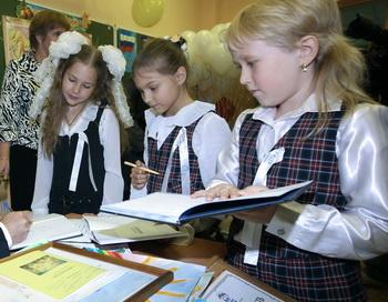 Школьники. Фото: MIKHAIL KLIMENTYEV/AFP/Getty Images