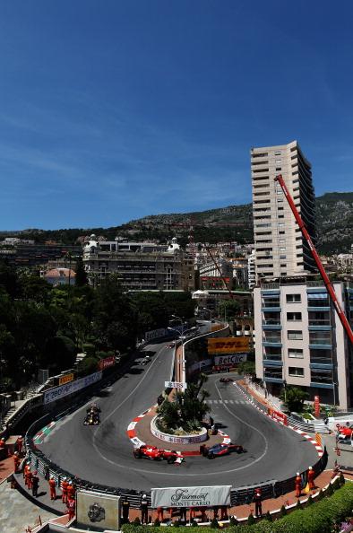 Себастьян Феттель  выиграл  Гран-при Монако «Формулы-1», Петров попал в аварию. Фоторепортаж из Монте-Карло. Фото: Paul Gilham/Vladimir Rys/Mark Thompson/ DIMITAR DILKOFF/AFP/Getty Images