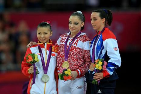 Алия Мустафина на Олимпиаде завоевала золото  в упражнениях на брусьях. Фоторепортаж. Фото: Streeter Lecka/Getty Images