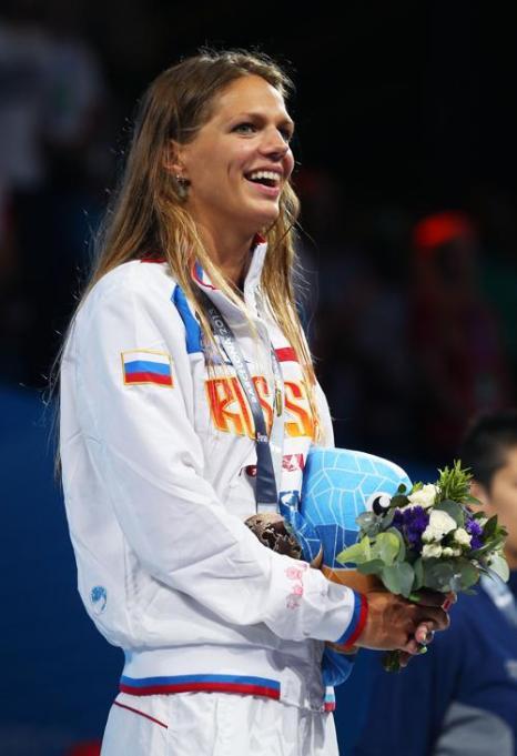 Российская пловчиха Юлия Ефимова стала первой в плавании брасом на дистанции 200 метров в Чемпионате мира по водным видам спорта 2 августа 2013 года в испанской Барселоне. Фото: Clive Rose/Getty Images