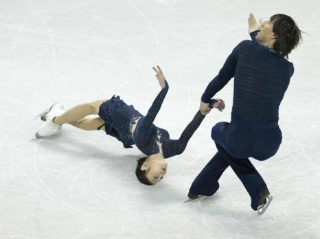 Юко Кавагути и Александр Смирнов на Чемпионате мира 15 марта 2013 года в Лондоне. Фото: GEOFF ROBINS/AFP/Getty Images