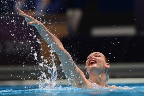 Синхронистка Ромашина выиграла третье золото Чемпионата мира по водным видам спорта 24 июля 2013 года в испанской Барселоне. Фото: JAVIER SORIANO/AFP/Getty Images