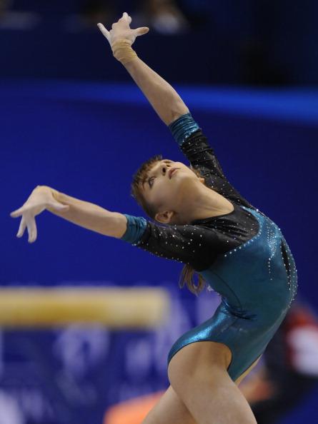 Женская сборная России по гимнастике на чемпионате мира в Токио завоевала серебро. Американские спортсменки  -  золото, китаянки – бронзу. Фото: KAZUHIRO NOGI/AFP/Getty Images