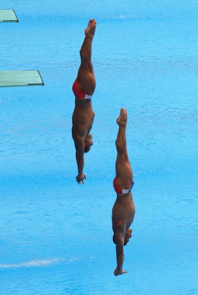 Фоторепортаж с соревнований по синхронным прыжкам в воду среди мужчин в четвертый день чемпионата  мира по водным видам спорта FINA. Фото:  Feng Li/Getty Images