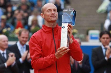 Фоторепортаж.  Николай Давыденко выиграл турнир BMW Open и автомобиль. Фото: Alexander Hassenstein/Bongarts/Getty Images